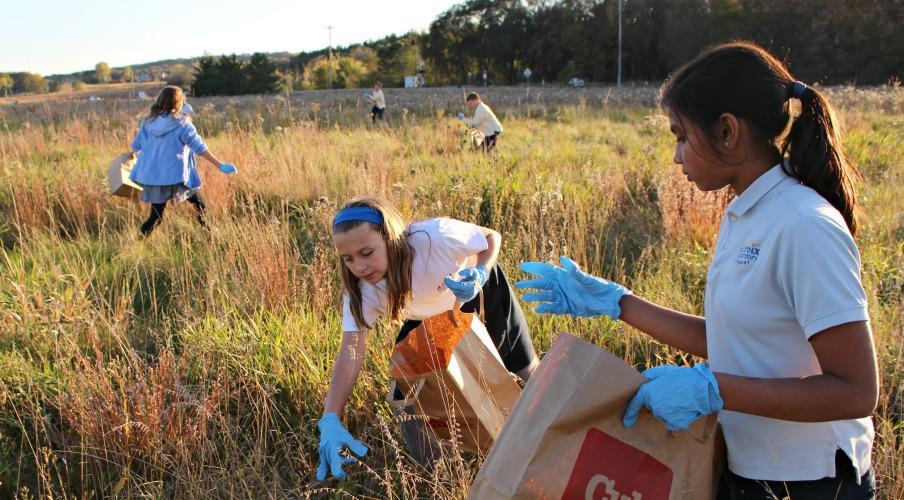 Kids pick prairie seeds